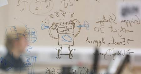 Drawing of robot and calculations on glass